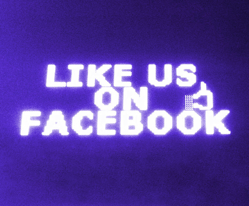 Like us on Facebook signage